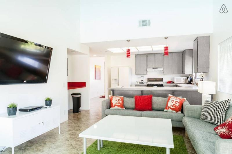 Living room and kitchen - that's a big TV!