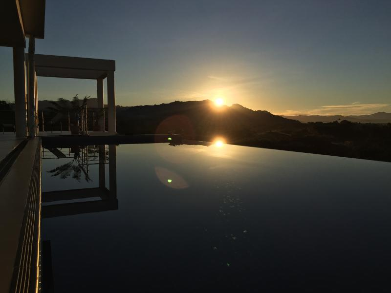 Sunrise over infinity pool