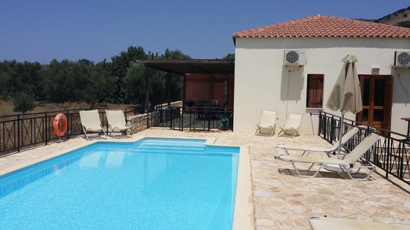 Pool area has 4 loungers and 4 easy chairs plus two outside armchairs and a sofa