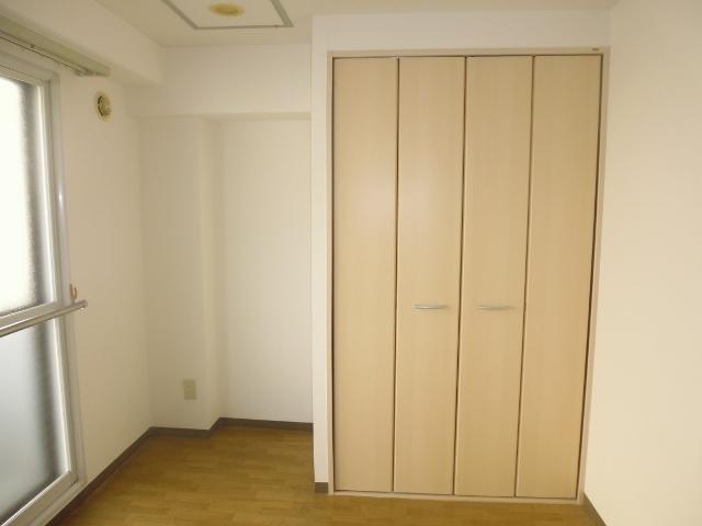 Big cupboard with hangers