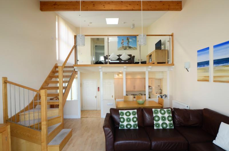 Waterfront accommodation double height lounge area