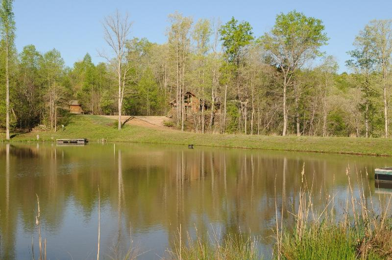 Cabin nestled between the pond and river