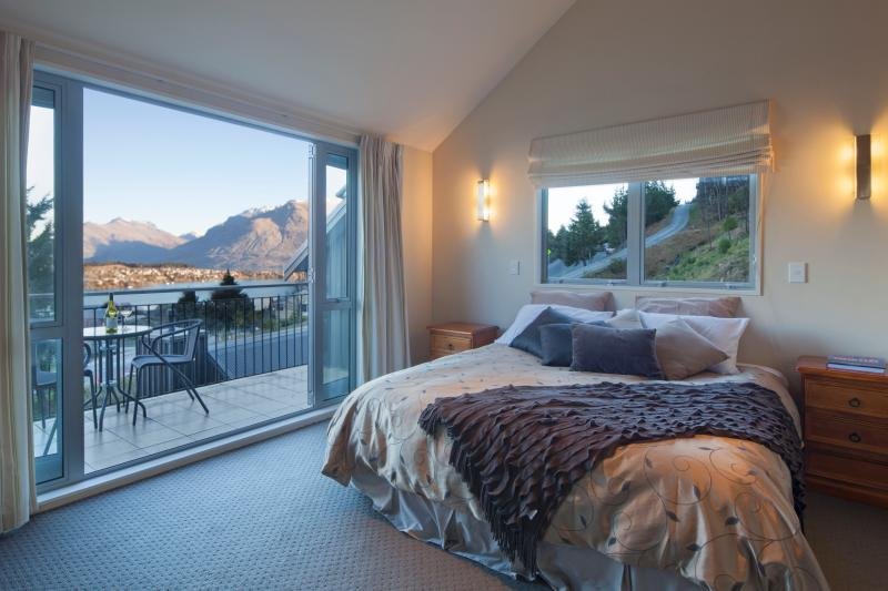 Main bedroom with balcony and spectacular views