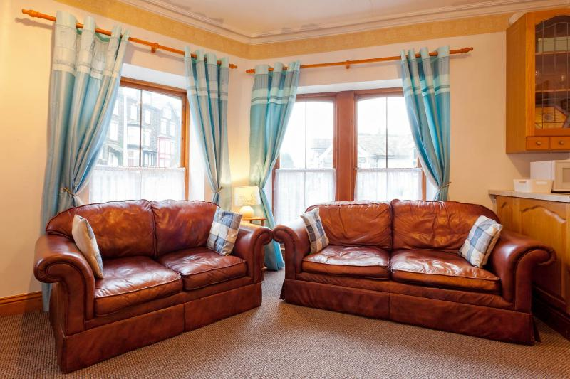 Lounge with double aspect bright and airey windows open, full central heating for the cooler nights