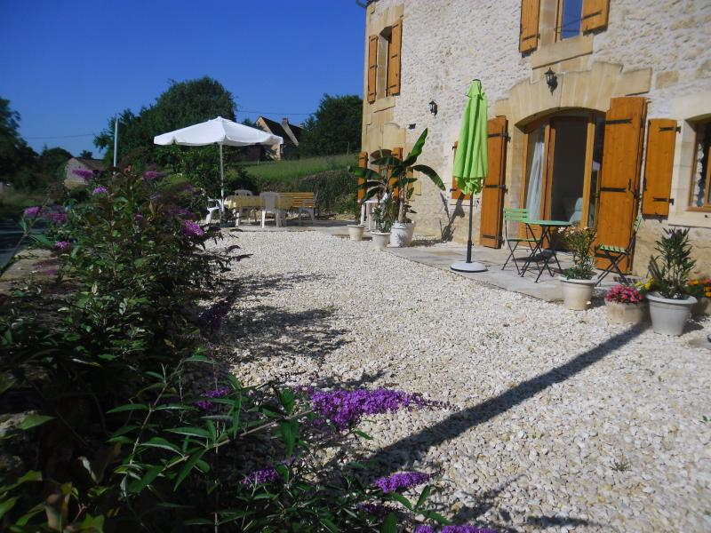 The Byre opens onto a pretty terrace with table, chairs, parasol & barbecue