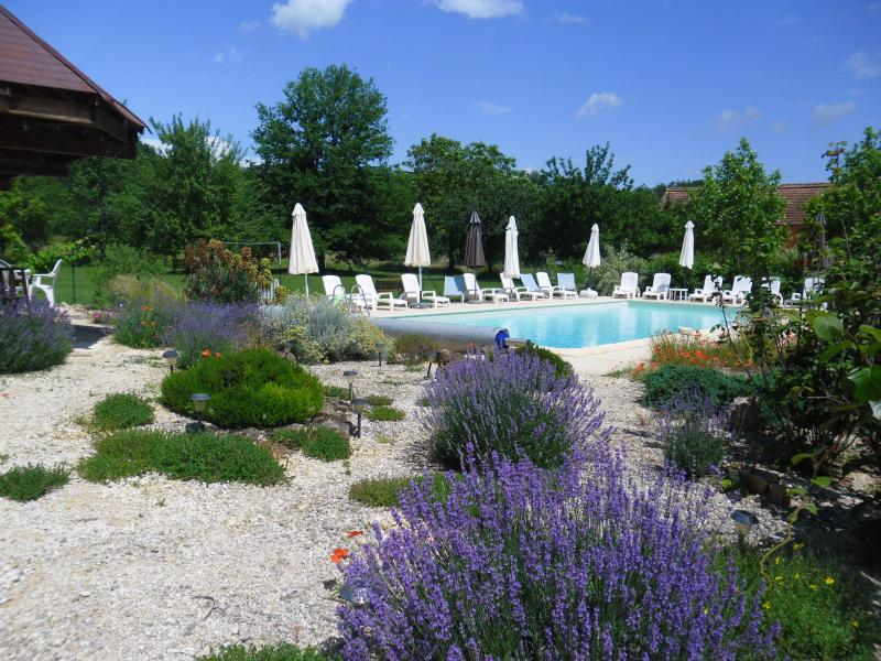 Pool garden, swimming pool and orchard beyond