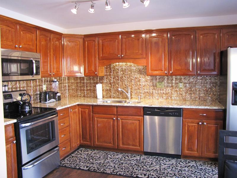 Beautiful updated Kitchen with granite slab counter tops and hardwood floors