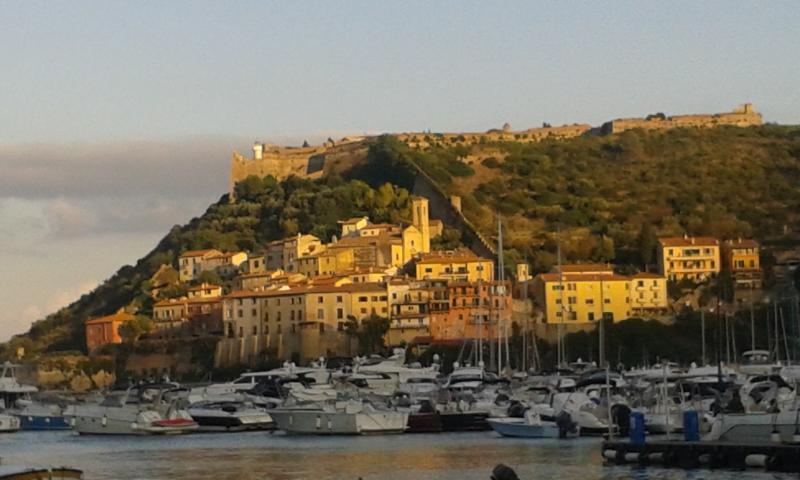 the Rocca from the sea with the old village under