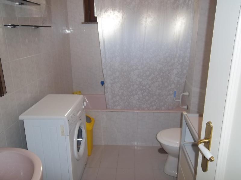 bathroom with pool and washmachine
