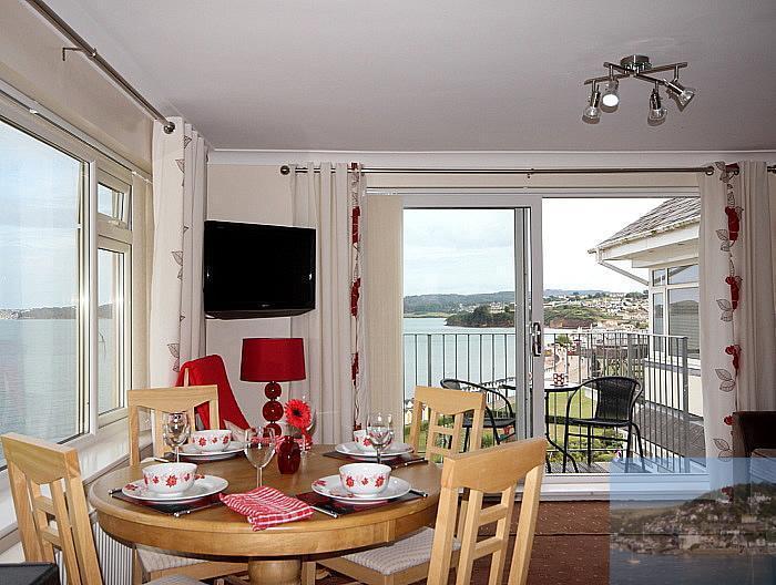 Light, triple aspect lounge.Balcony & panoramic views over the beach & the bay.