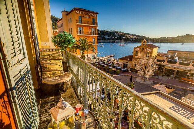 Stunning views from the sunny balcony of Casa Carlotta over the bay and village squarely