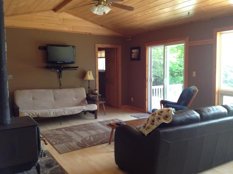 Living Room, large patio doors open to the deck area