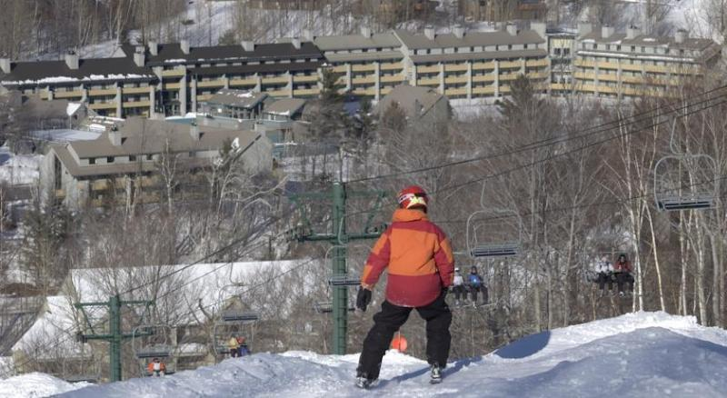 Skier looks out at Loon Village