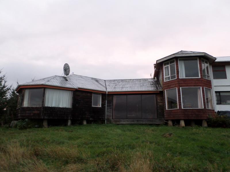 Facade of larch shingles. House Hostel.