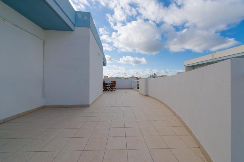 Large terrace with outdoor furniture and BBQ
