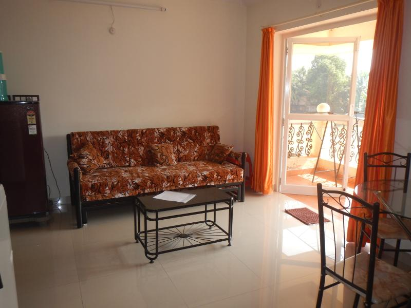 Living / dining room with double sofa bed and balcony