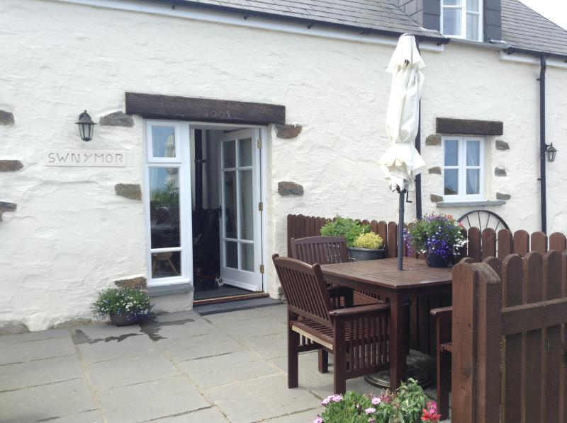 Patio area outside Swn y mor is ideal for breakfast in the sun!
