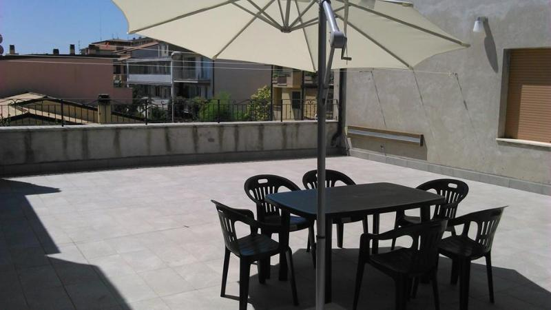 The terrace of approx. 100sqm with table and umbrella