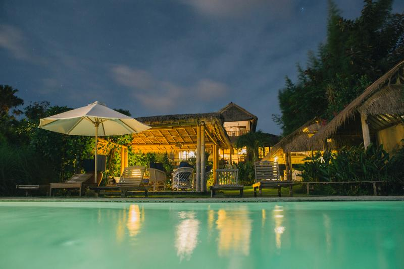 Swimming pool and Villa by night.