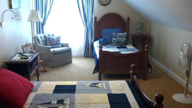 Bedroom #3 on second floor with two twin size beds plus a trundle bed which pulls up to same height
