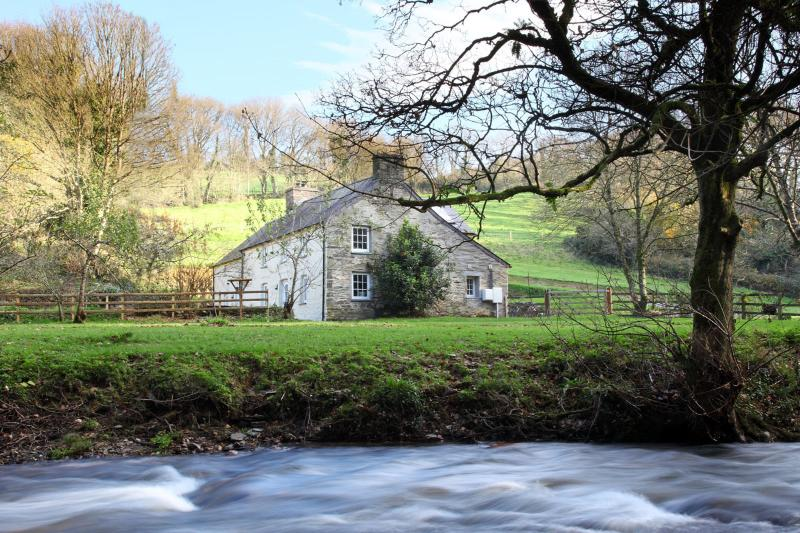Wrapped with the river Nevern along the edge of the garden grounds in a unique tranquil setting.