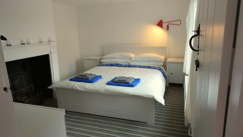 Master Bedroom, Kingsize bed, storage and hanging space, TV with DVD player.