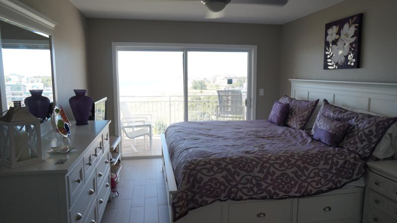 Newly renovated and furnished master bedroom with King bed with flat screen and walk in closet.
