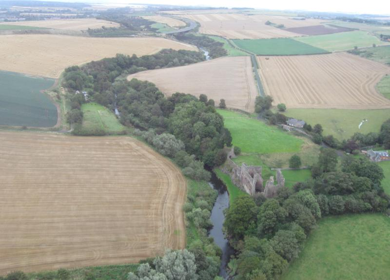 Aerial view of Overhailes Farm, the River Tyne and ruins of Hailes Castle