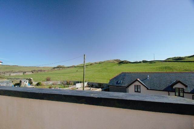the view sideways from the roof terrace over to the NT land