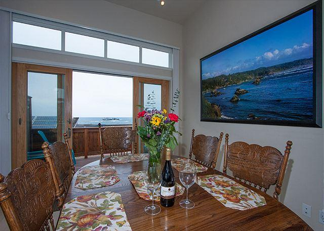 Ocean views from french doors to deck and photographic art.