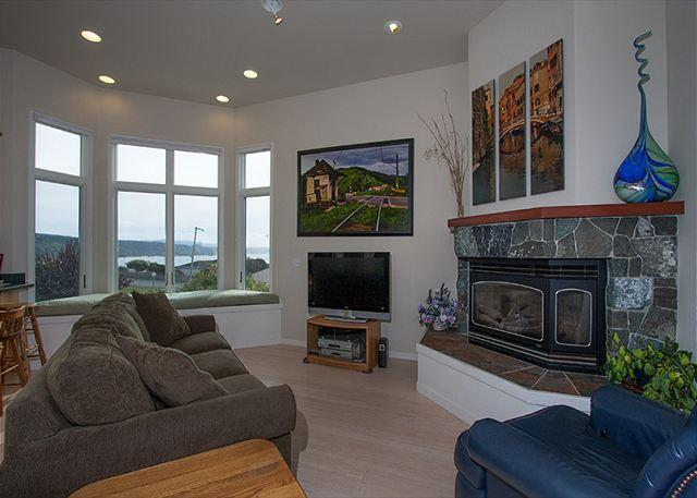 Relax in front of the fire, watch T.V. or gaze out at the bay.