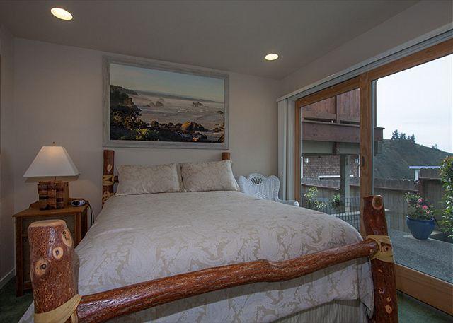 Downstairs- bedroom 1 opens to patio & ocean views.
