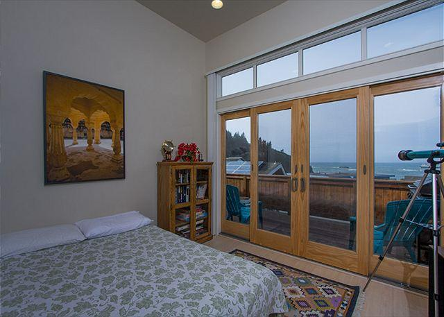 Bedroom 2 has a futon bed with ocean views & access to deck.