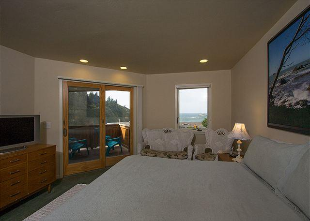Soak up the ocean views while laying in the Master King bed.
