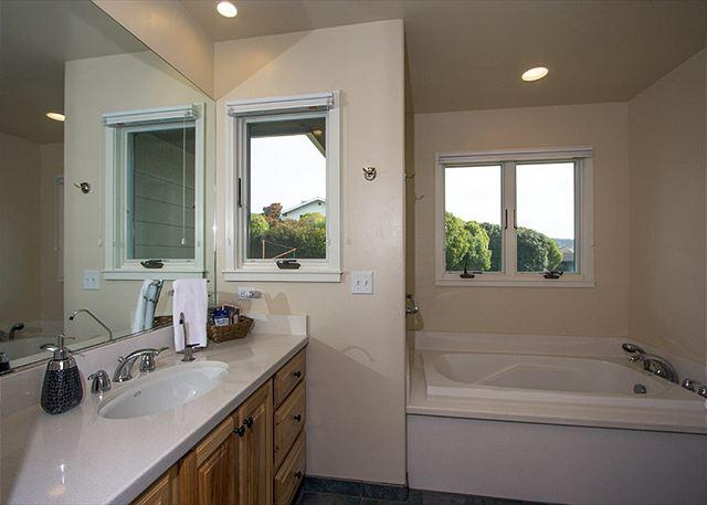 Master bathroom 3 has a large bathtub to soak in after a hike.