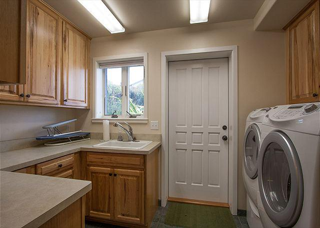 Well equipped laundry room w/ iron & ironing board is downstairs