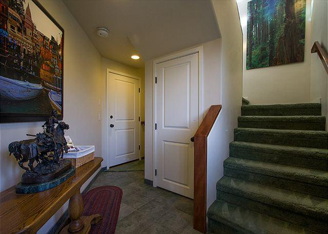 Enter on lower level - 1 bed/1 bath & laundry room