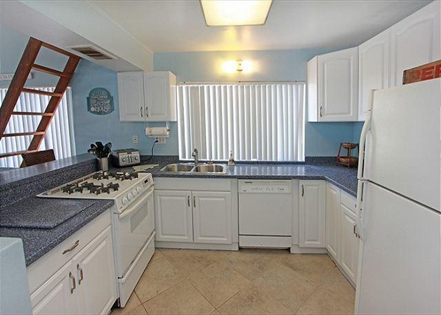 Kitchen w/ corian countertops