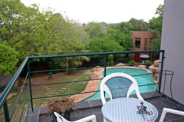Balcony overlooking the garden and pool