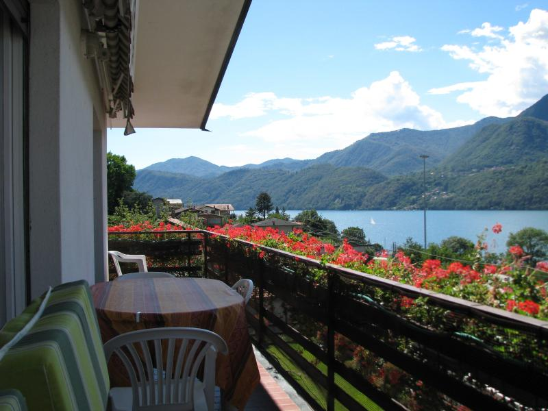 Relax with a glass on wine on the balcony looking at the Orta Lake