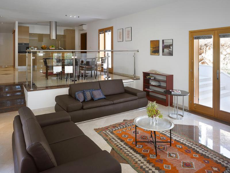 Spacious living room with adjoining kitchen