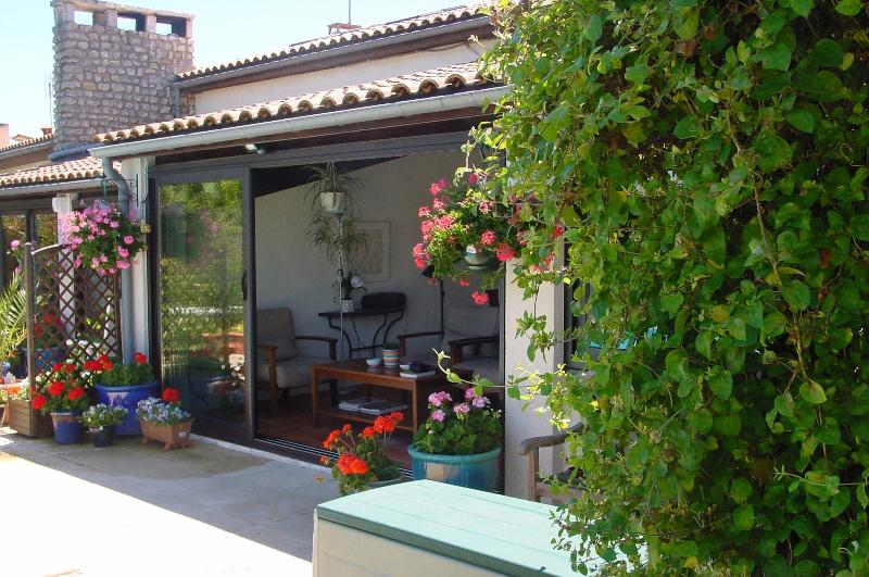 Your superb all-weather garden room with sliding glass doors