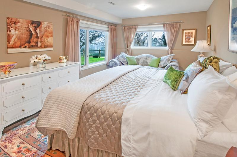 Master Bedroom, King bed, Fine Linens, Down chesterfield. Wake to beautiful views.
