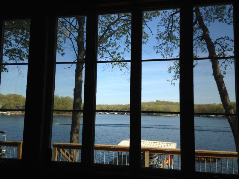 Wall of windows in the living room for great views of the lake