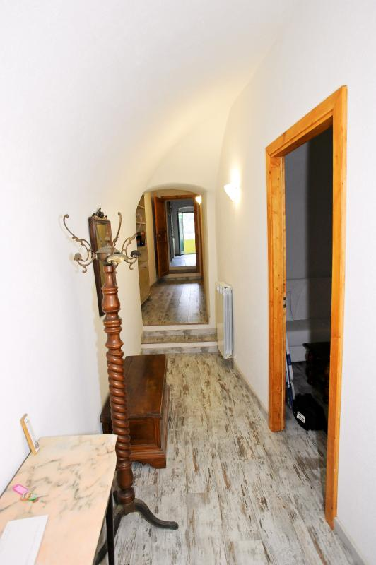 The corridor leading to 2 of the 3 bedrooms, to 1 of the toilets and to the kitchen