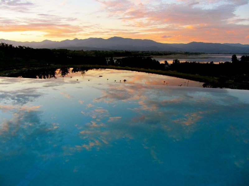 sunset reflecting in pool, pond and Motueka inlet