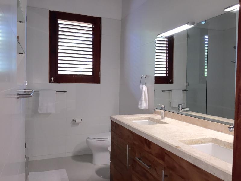 Master bath with double sinks, bidet, glass shower and gorgeous tile