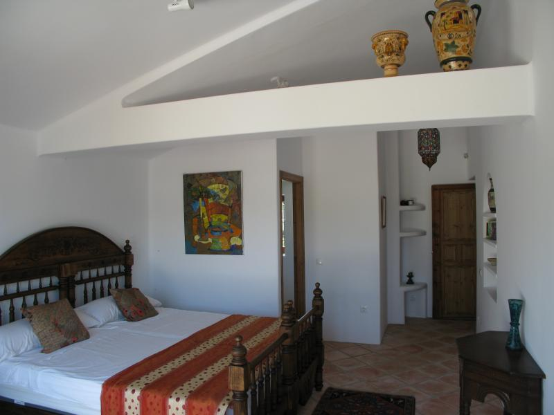Top floor bedroom, with private terrace and views of castle, village and mountains