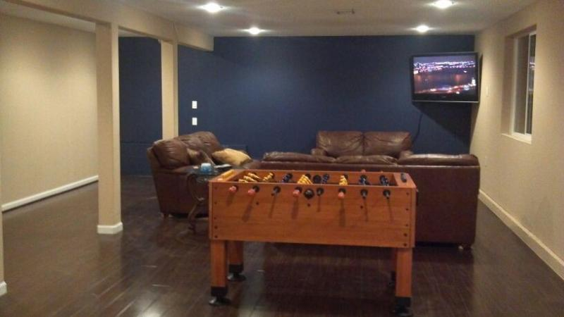 Large open concept game room (full size pool table and foosball) located on the lower level