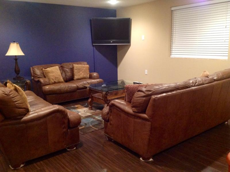 Oversized leather sofas and large HDTV in the game room!